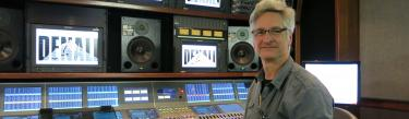 Hugh Healy at a Calrec Apollo broadcast audio mixing console