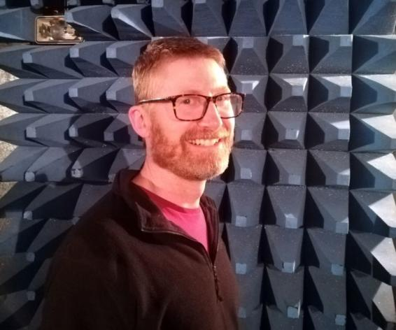 Gary Burns, Compliance Electrical Design Engineer in Calrec's anechoic chamber.