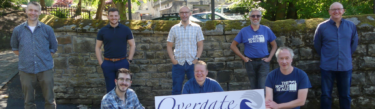 Members of staff outside Calrec's Nutclough Mill in Hebden Bridge ahead of their Yorkshire Three Peaks challenge in aid of Overgate Hospice
